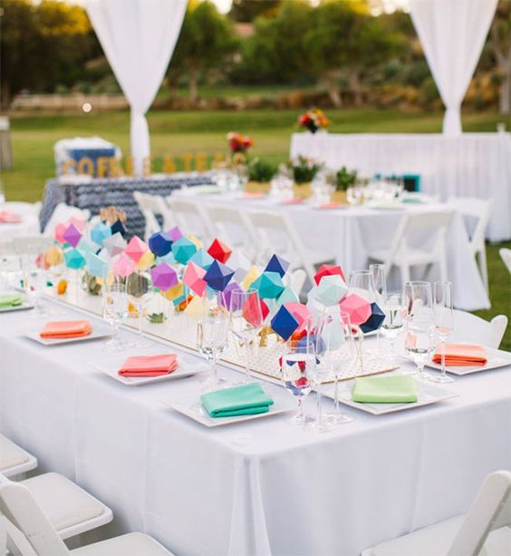 a colorful geometric wedding centerpiece of geo figures and bold colors is great for a modern wedding