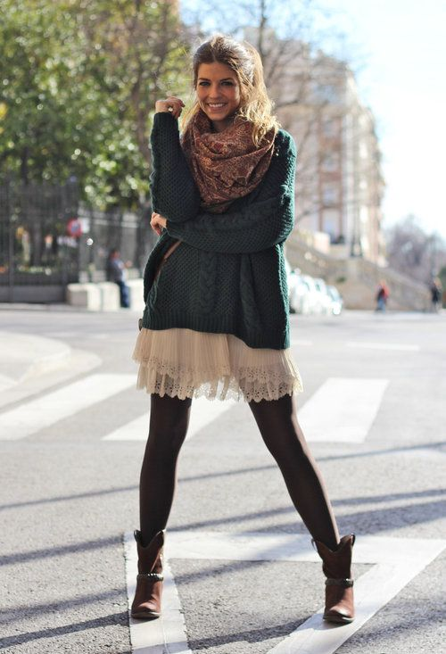 an oversized dark green sweater, a white lace skirt, black tights, brown booties and a brown scarf