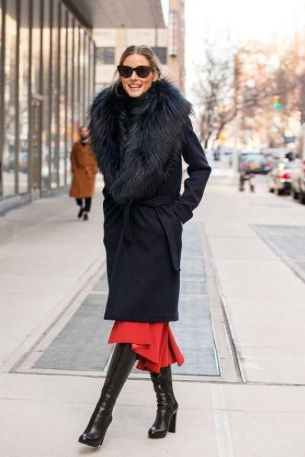 a black knee coat with a large faux fur stole for very cold winter days