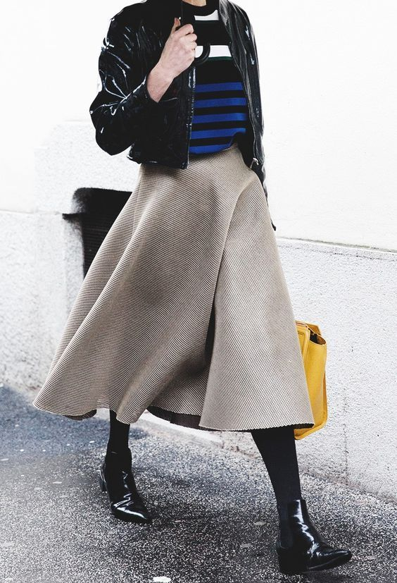 a striped sweater, a black cropped leather jacket, a wooden midi skirt and chelsea boots