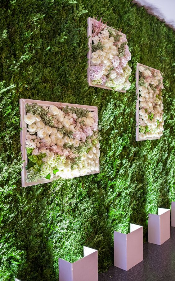 a living wall with frames filled with lush blooms to make a romantic statement