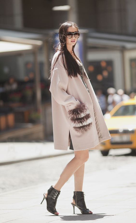 a pink coat with faux fur striped pockets to make it even more eye-catching