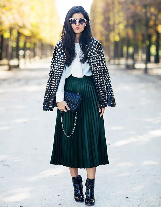 a dark green pleated midi skirt, a white shirt, a nail leather jacket and black booties