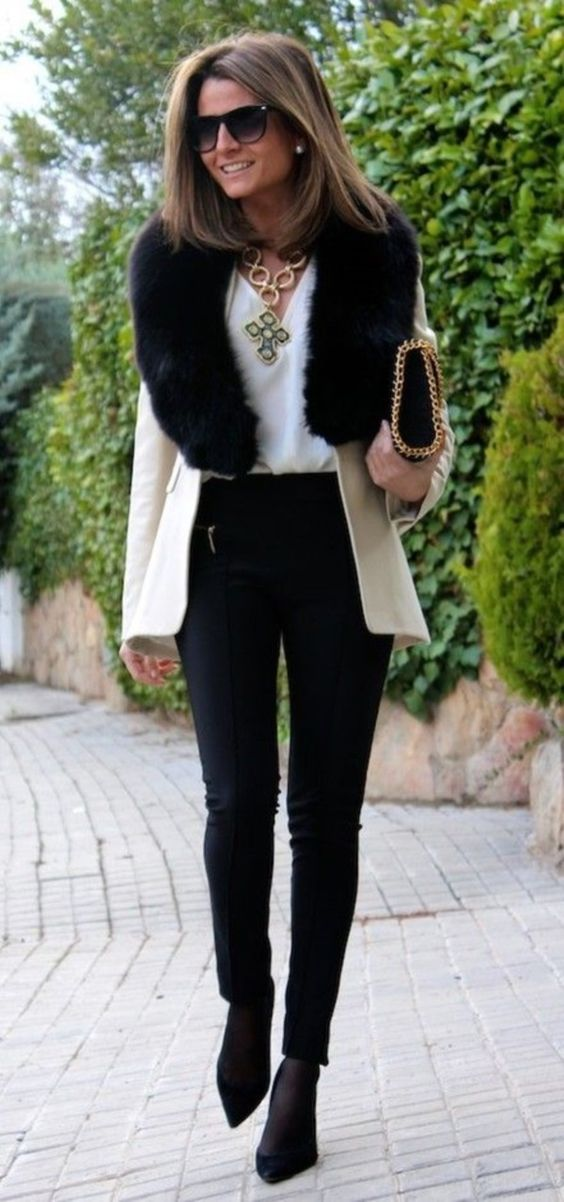 a creamy short coat with a black faux fur stole looks very elegant and chic