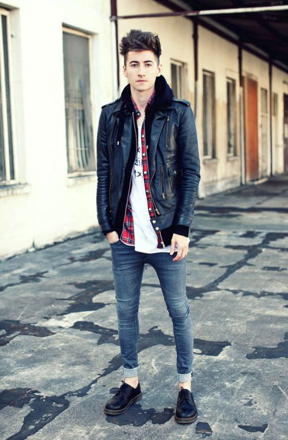 With white t-shirt, black leather jacket and black shoes