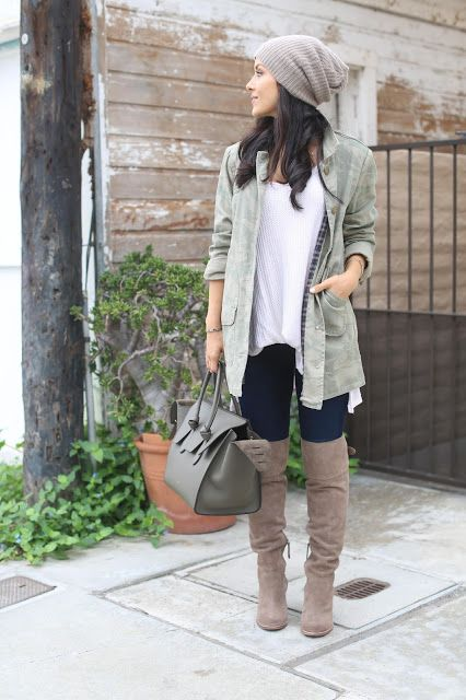 a neutral slouchy beanie matches the tall boots and keeps warm