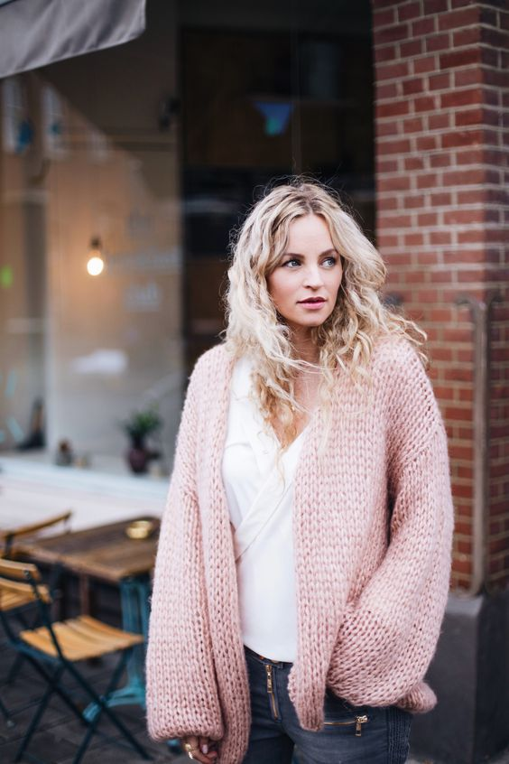 grey denim, a white shirt and a pink chunky knit cardigan