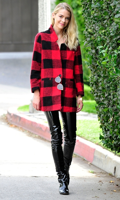 With plaid shirt and black boots