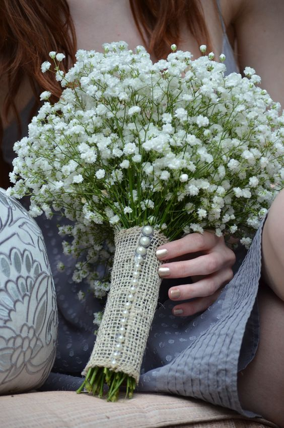 a burlap wrap with pearl buttons for a rustic bride - you can easily DIY it