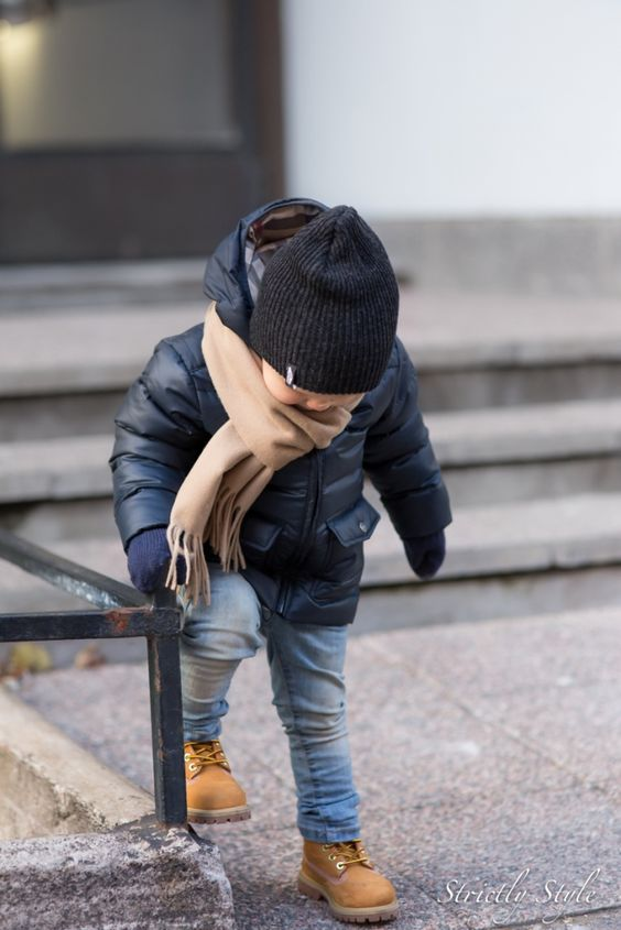 a black puffer jacket, a black beanie and a beige scarf for a stylish boy's look