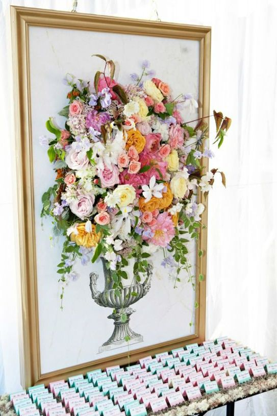 a gilded frame with an artwork completed with fresh blooms looks really wow
