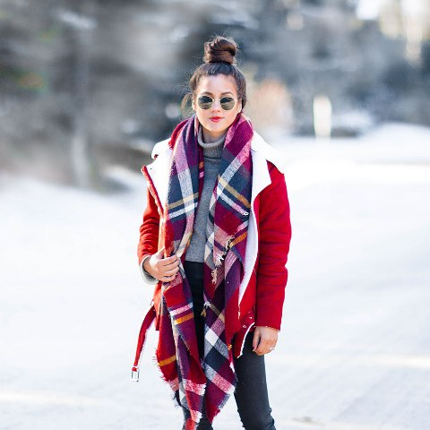 With gray turtleneck, jeans and red shearling jacket