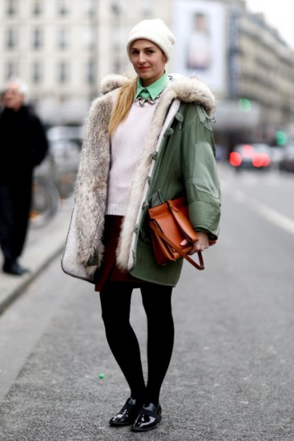 With green shirt, white sweater, marsala mini skirt, black tights, flat shoes, beanie and brown bag