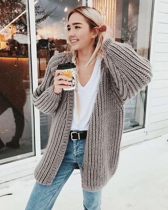 blue jeans, a white tee and a comfy neutral chunky knit cardigan