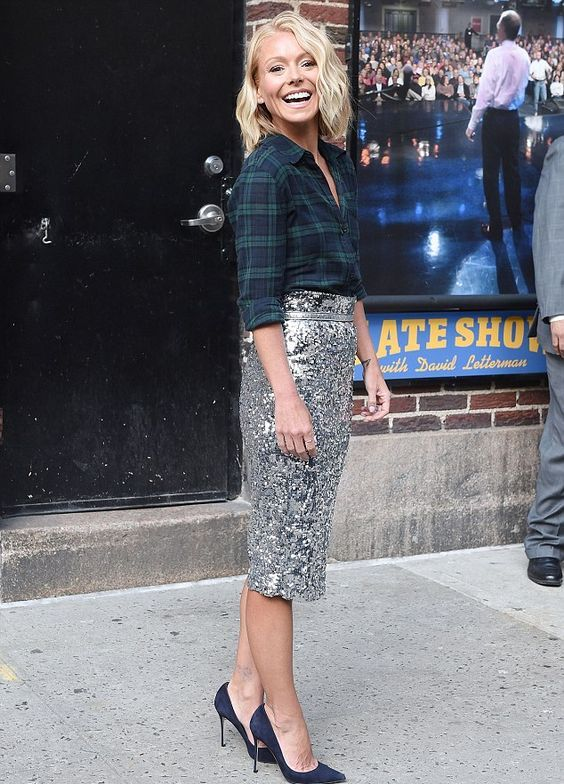 a dark green plaid shirt, a silver kneed pencil skirt and navy suede shoes