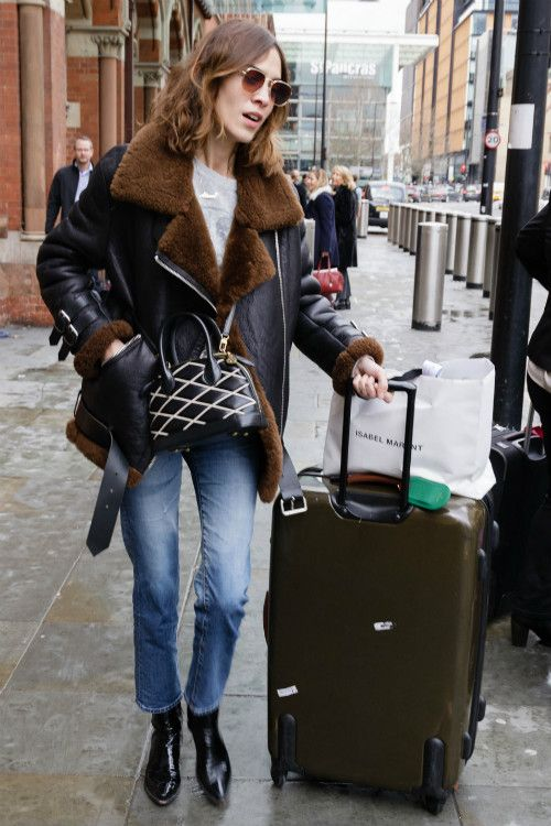 cropped jeans, black boots, a grey tee, a black shearling coat with faux fur
