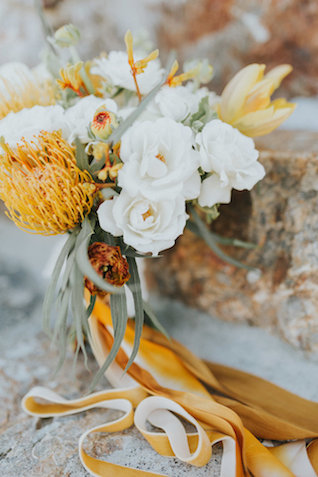 Yellow bridal bouquet with ribbons