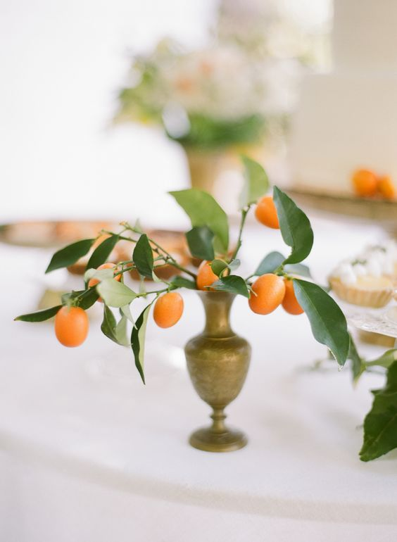 some kumquats in a vintage vase can become a chic vintage-inspired centerpiece