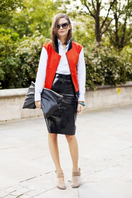 With white button down shirt, leather pencil skirt, beige shoes and clutch