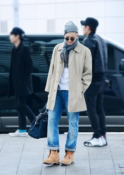 blue jeans, amber boots, a white tee, a neutral coat and a beanie