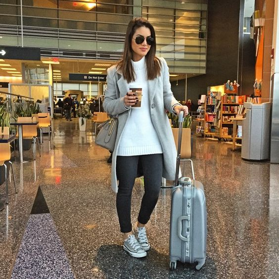 black denim, a white sweater, a grey coat and grey sneakers