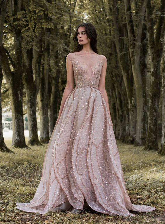 a pink cap sleeve wedding dress with an illusion neckline, embroidery and sparkling rhinestones