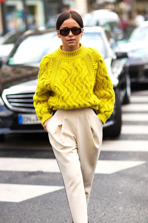a lemon yellow chunky knit sweater and creamy pants with pockets