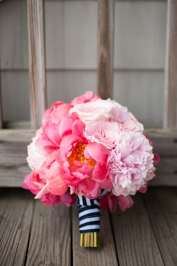 navy and white striped ribbon for a bold pink peony bouquet and a nautical bride
