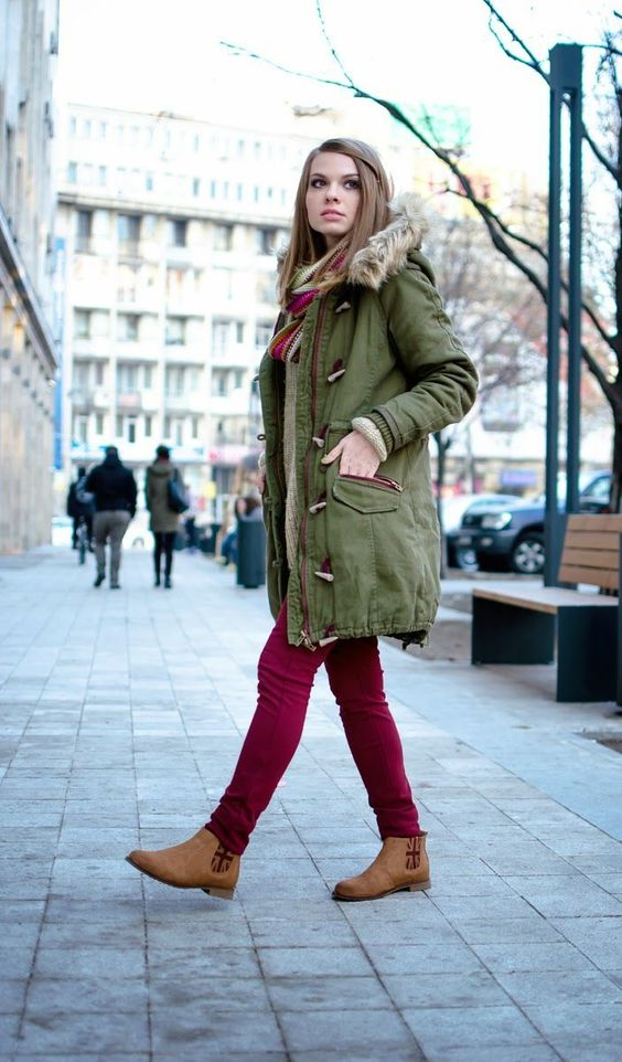 an olive green parka, fuchsia jeans and amber chelsa boots