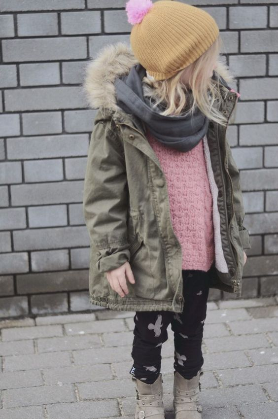 an olive green parka with a black scarf for a cool fall-inspired look