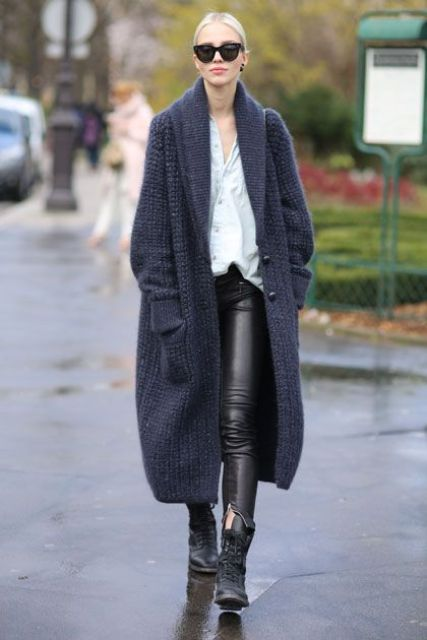 black leather pants, a white shirt, black boots and an extra long navy cardigan