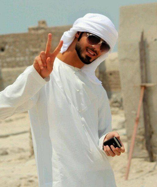 Omar Borkan white dress