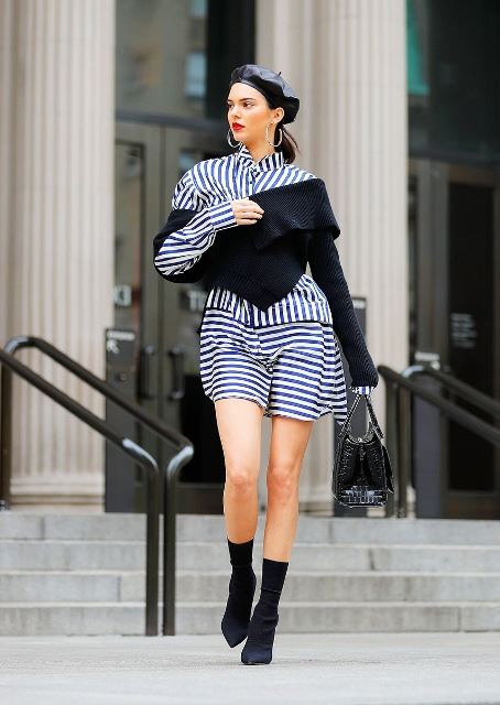 With striped dress, sock boots and leather bag