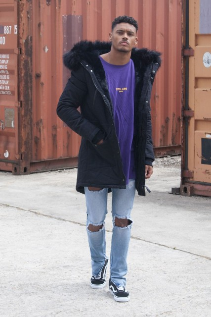 With bright color oversized t-shirt, distressed jeans and sneakers