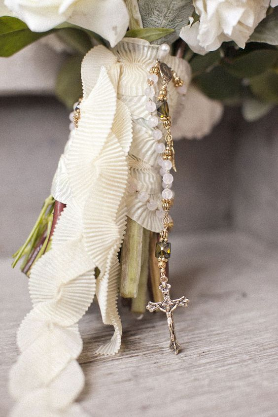 ruffled ribbon and a rosary for a romantic bride