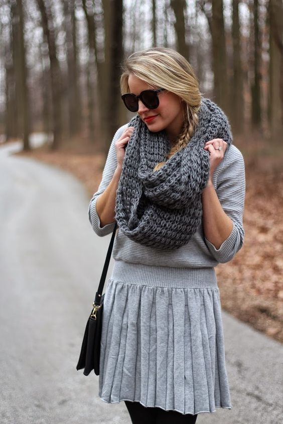 a grey dress with a pleated skirt and a dark grey chukny knit scarf
