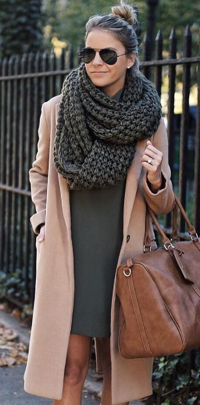 an olive green mini dress, a camel coat and a grey chunky knit scarf