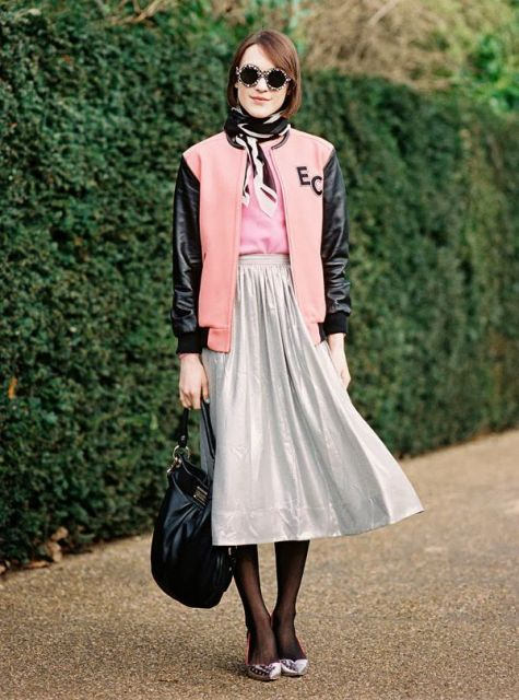 With pale pink shirt, midi skirt, black tights, metallic shoes and black bag