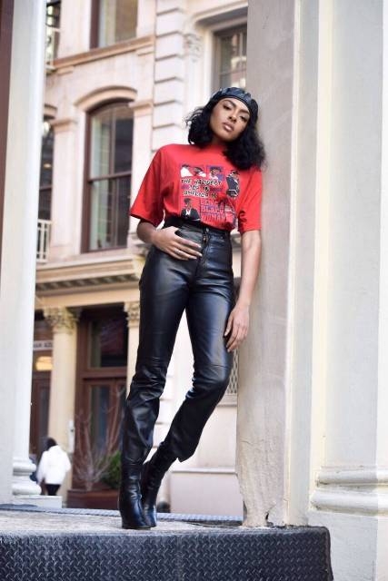 With red printed shirt, leather pants and boots