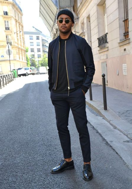 Black beanie, bomber jacket, t-shirt, trouserss and oxford shoes