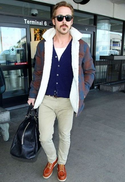 neutral pants, a white tee, a navy cardigan, a colorful shearling coat and bold shoes