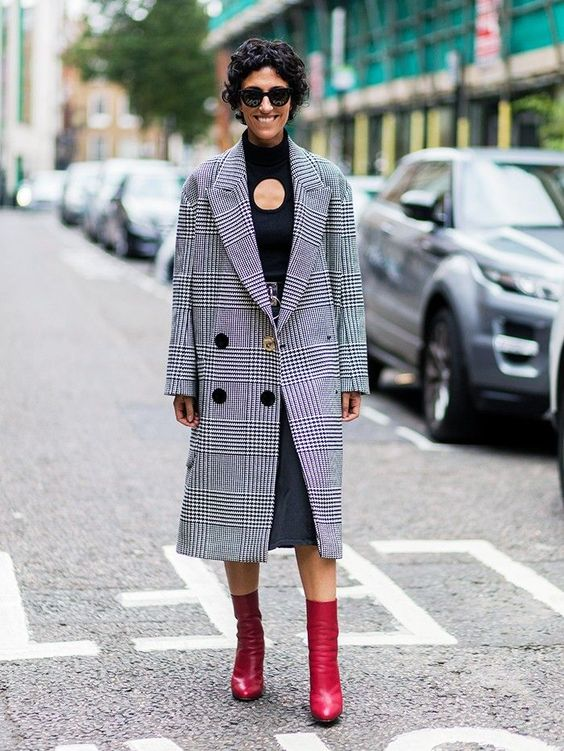 a denim midi, a black turtleneck, red sock boots and a plaid coat