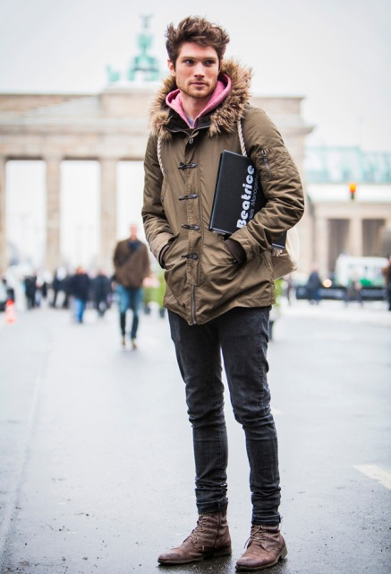 With pink hoodie, jeans and brown boots