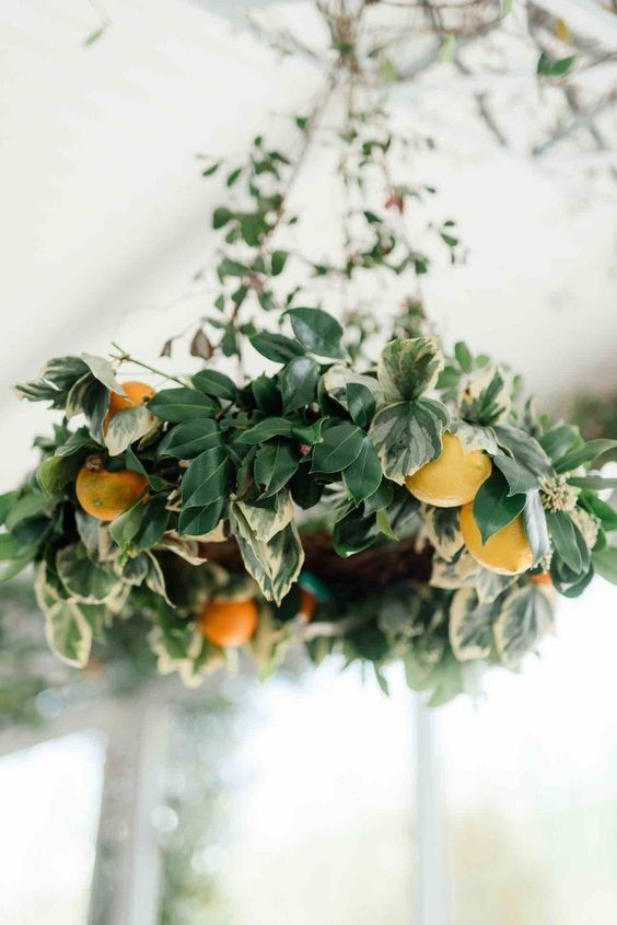 a lush foliage and orange chandelier will make your venue more eye-catching and gorgeous
