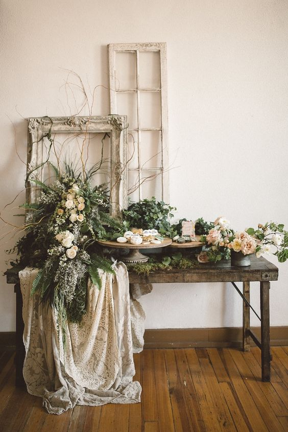 add a refined touch to your dessert table with picture frames, blooms and some lace