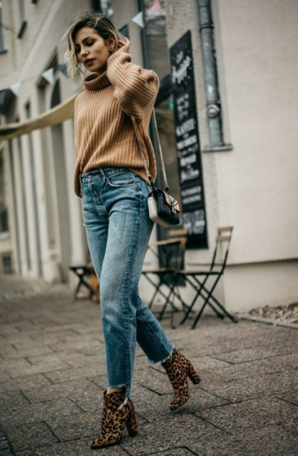 With brown sweater, embellished bag and leopard printed boots
