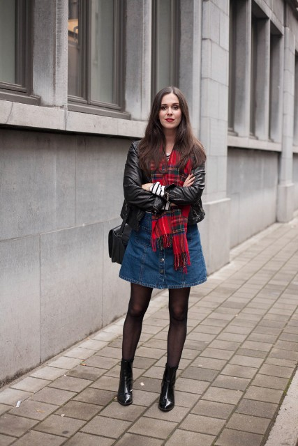 With leather jacket, denim skirt, mid calf boots and black bag