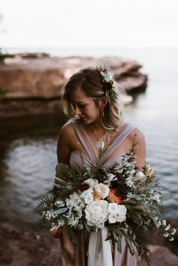 The bridal bouquet was a lush one, with white and orange blooms and lots of greenery