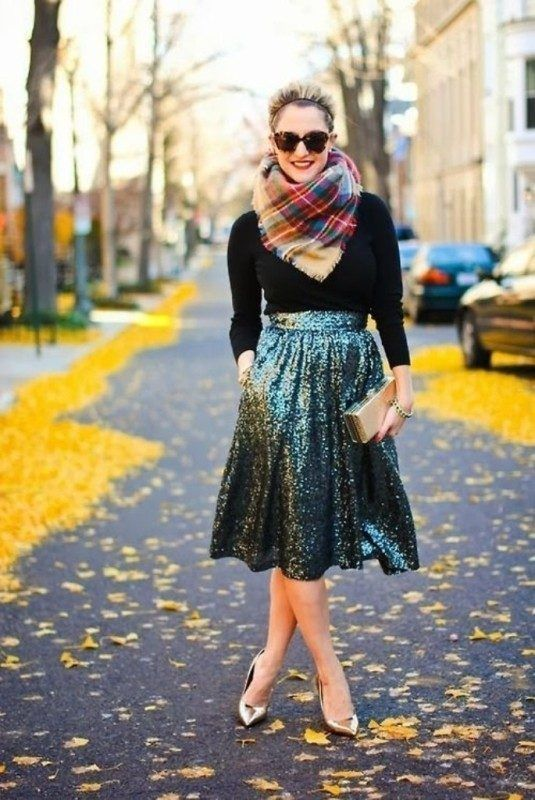metallic shoes, an emerald sequin midi skirt, a black turtleneck and a plaid scarf