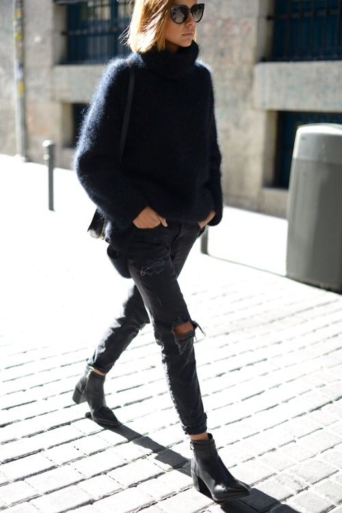 ripped black jeans, black boots and an oversized black angora sweater